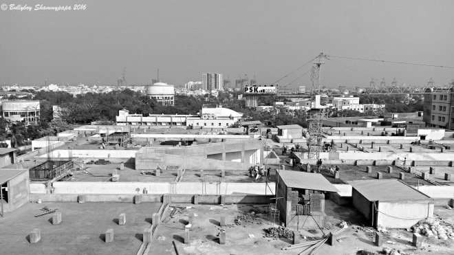 A black and white picture of building construction