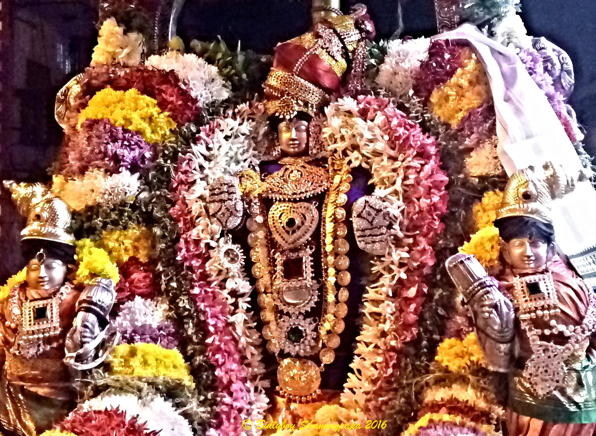 Simply Divine - A picture of God Vishnu with his consorts Sridevi and Bhudevi