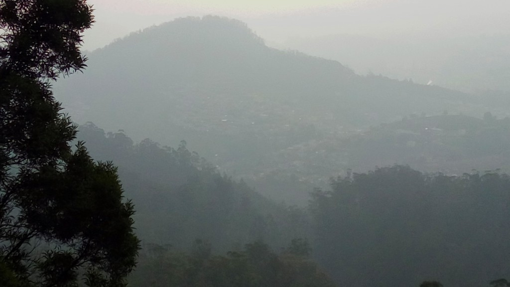Reflecting on Qualm - A view of a misty mountain range
