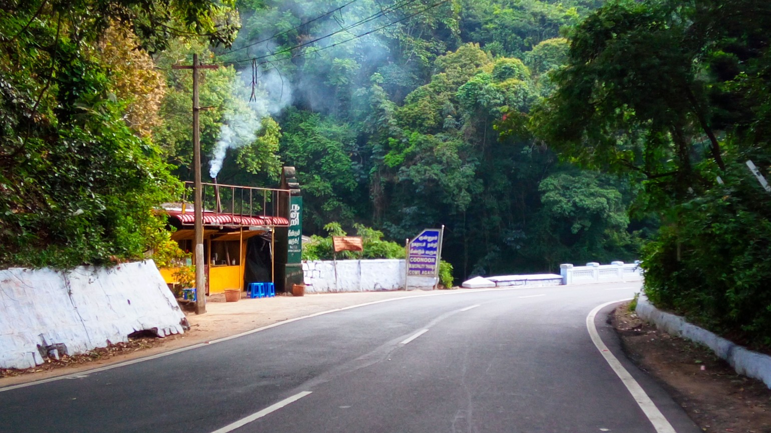 Bends and Slopes - A view of a roadside tea-shop near a bend on the mountain