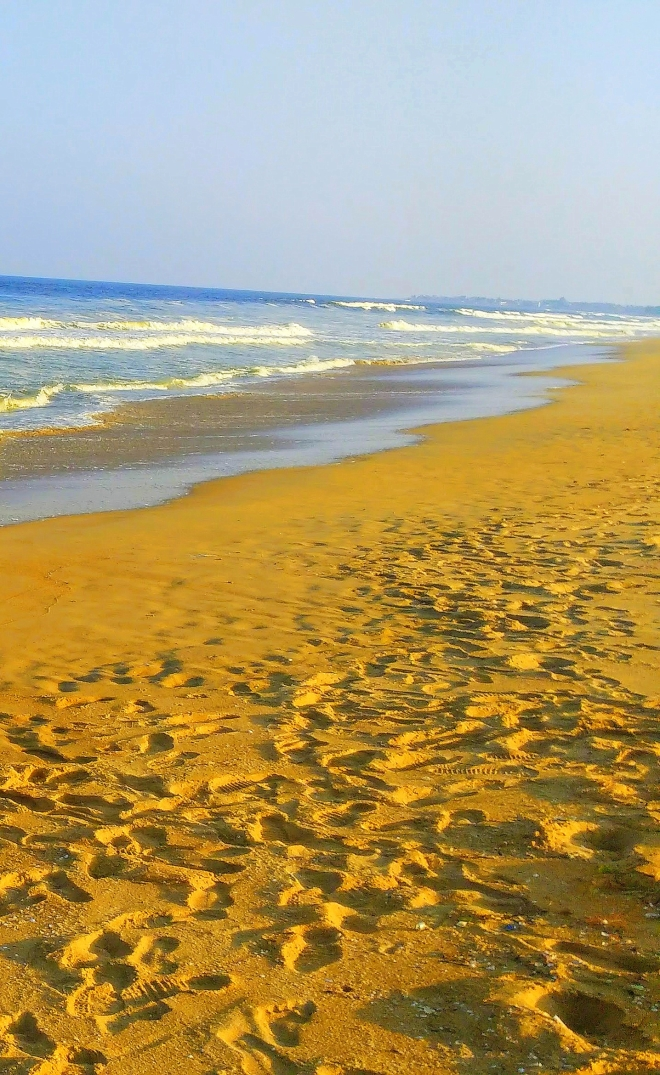 Pedestrian Sands - A picture of footprints along the seashore
