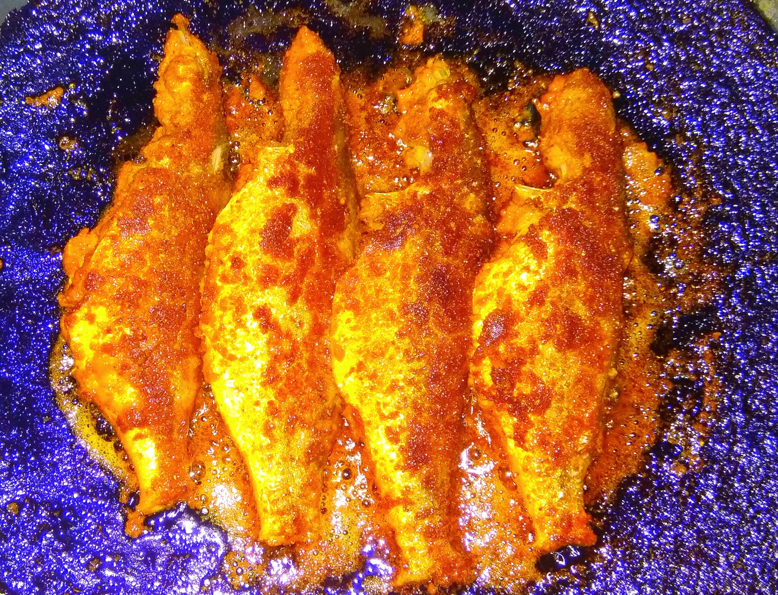 Cook, Eat and Drink - A picture of four fried fish