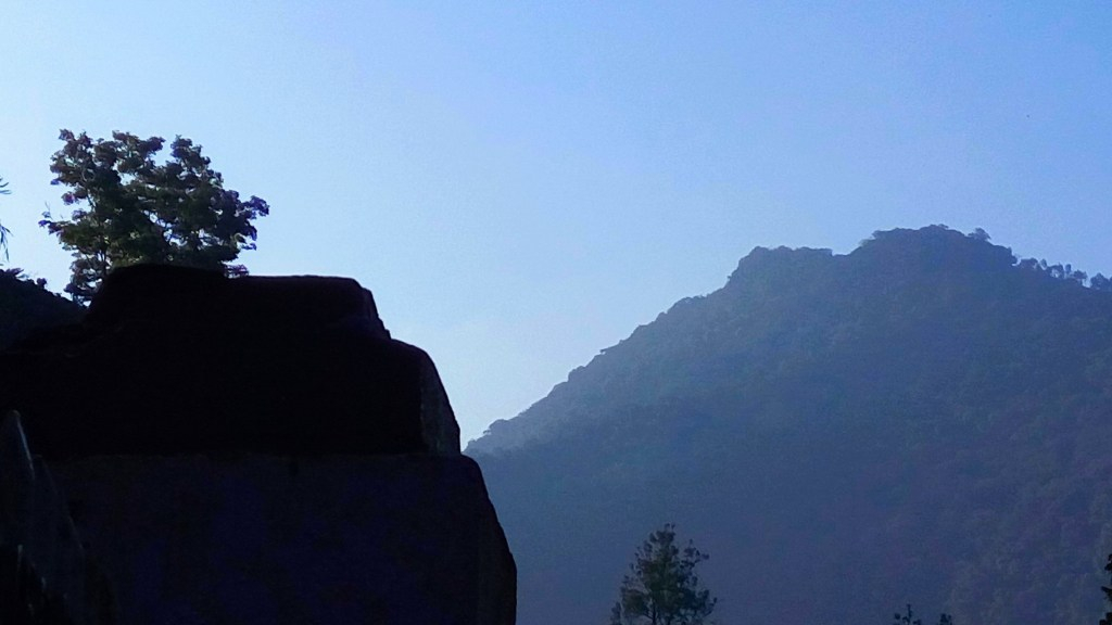 Every Tuesday - Bends and Slopes - A view of a silhouette of mountains